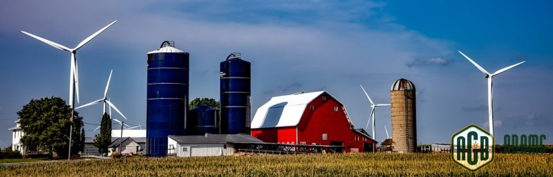 Grain Silos on Farm by Barn